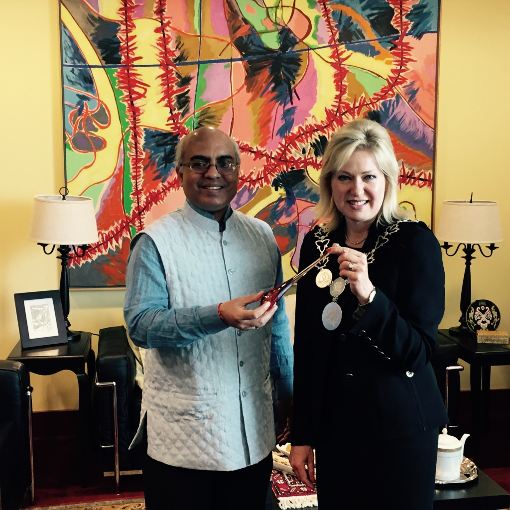 Mayor Crombie presenting Consul General Mishra with a hand-made glass ornament designed by Alyssa Getz and Tommy Cudmore, local Mississauga artists.