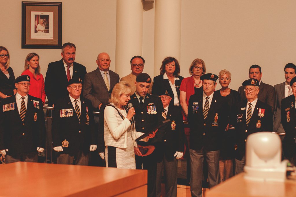 Mayor Crombie presents Mr. Carrubba with the Rotation Bar and Commander-in-Chief Unit Commendation.