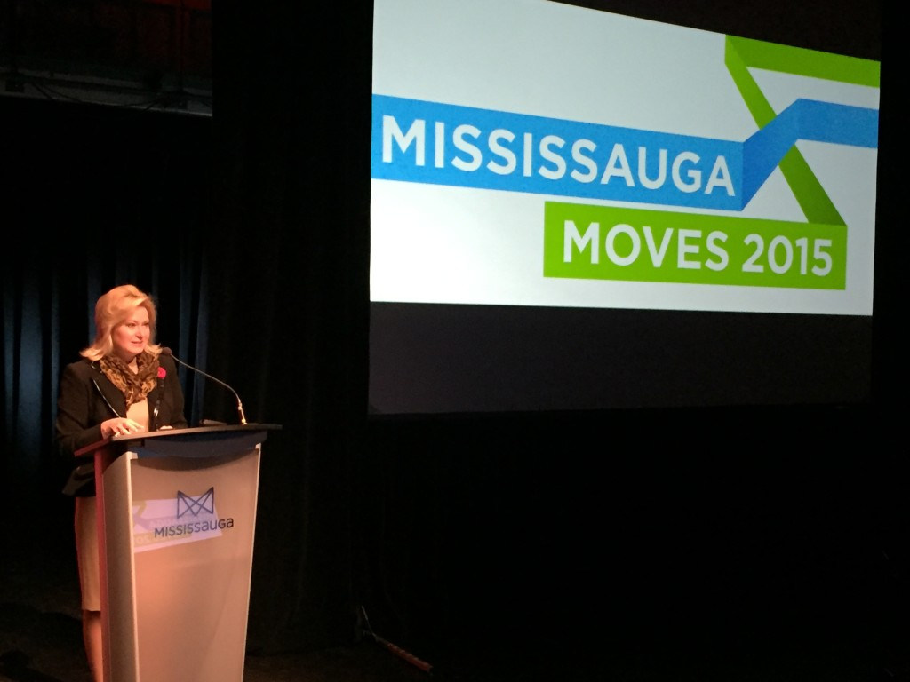 Mississauga Mayor Bonnie Crombie speaking to a room of nearly 250 participants during the Mississauga Moves 2015 Transportation Summit at the Living Arts Centre.