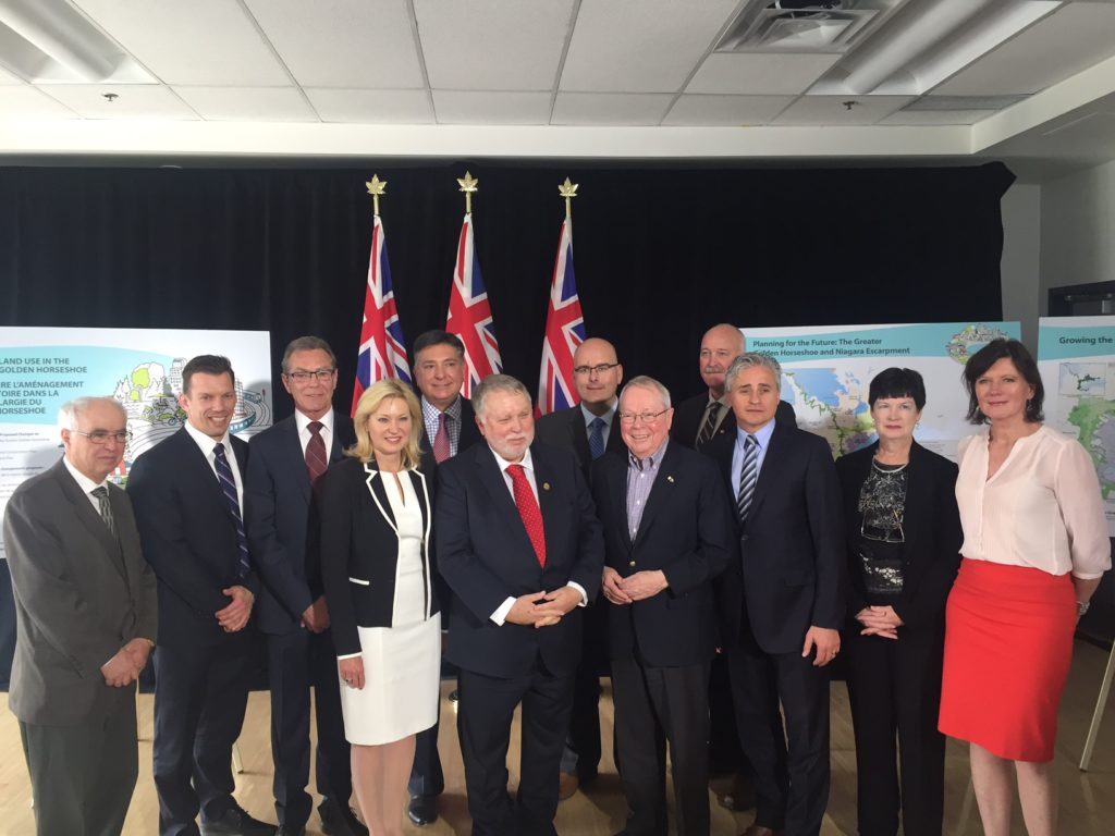 Mayor Crombie joins Ward 1 Councillor Jim Tovey; Ted McMeekin, Minister of Municipal Affairs and Housing, Bill Mauro, Minister of Natural Resources and Forestry, Steven Del Duca, Minister of Transportation, and Charles Sousa, Minister of Finance and MPP for Mississauga South.